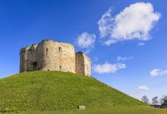 York Cliffords Tower UK. Clifford`s Tower in York, England,is the remains of a 13th century castle and commands a view of the surrounding countryside from its Stock Photos