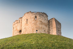 Clifford's Tower in York, UK. Clifford's Tower on the Hill in Twilight located in York, UK Royalty Free Stock Images