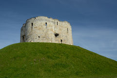 Cliffords's tower a stone monument in York UK. Cliffords's tower is a stone monument and fortification standing on top of a high grass bank in York UK Stock Photography