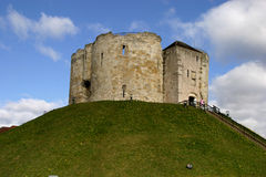 Cliffords Tower York. York Castle' is part of the city of York. The Castle itself was later dismantled, but the site contains Clifford's Tower, a quatrefoil keep Royalty Free Stock Photo