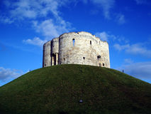 Cliffords Tower - York. The tower stands on a high mound erected by William the Conqueror as part of his campaign to overthrow the North. He threw up two mottes royalty free stock images