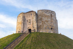 Cliffords Tower in York. Clifford's Tower, the inner keep and all that remains of the original York Castle, built by William the Conqueror in the 11th Century Stock Photos