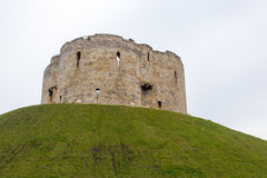 Cliffords Tower in York. Clifford's Tower, the inner keep and all that remains of the original York Castle, built by William the Conqueror in the 11th Century Royalty Free Stock Photos