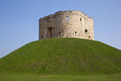 Cliffords Tower - York - England. Cliffords Tower - the keep of York Castle in the city of York in north east England. This medieval Norman castle was built on Stock Images