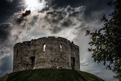 Cliffords Tower in York in England the UK. At dusk Stock Image