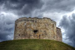 Cliffords Tower, York UK England. A storm brewing behind Cliffords Tower in York England, UK. Clifford's Tower is one of the best-loved landmarks in York. It Stock Photography