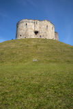 Cliffords Tower in York. A view of the Cliffords Tower, also known as York Castle in the historic city of York in England Royalty Free Stock Image