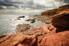 Cliffs. Red Cliffs near Arboarth, Scotland, UK Stock Photography