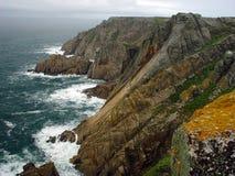 Cliffs. Coastline with 'devil's slide' rock, Lundy Island, UK Stock Image