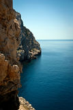 Cliffs. Rocky coast of Sardinia, Capo Caccia, the Foradada island Royalty Free Stock Images