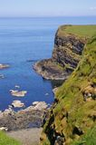 Cliffs. Grassy cliffs of a dramatic coastline in Northern Ireland Stock Images