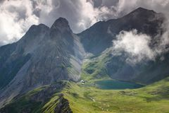 Cliffs above lake Obstanser See Carnic Alps East Tyrol Austria royalty free stock images