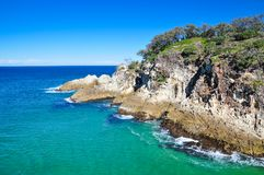 Cliffs along a coastline on the east coast of Australia. A turquoise sea and cliffs along a coastline on the east coast of Queensland, Australia Royalty Free Stock Photography