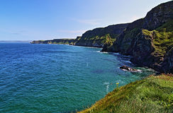 Cliffs along Irish Coast next to tiny Carrick-a-rede island Stock Images