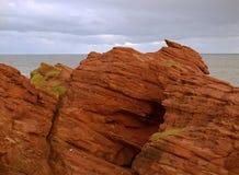 Cliffs in Arbroaht. Coastal rock cliffs in Arbroath in Scotland Stock Photo