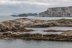 Cliffs around Ballintoy Harbour. Moyle, Northern Ireland, UK royalty free stock photos