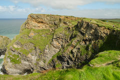 Cliffs around Hells Mouth, Cornwall. With small figures on coastal path Royalty Free Stock Photos