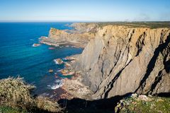 The steep cliffs of arrifana,portugal stock photography