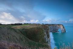 Cliffs and Atlantic ocean in dusk Stock Images