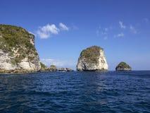 Cliffs in Balinese sea, Nusa Penida in Indonesia Stock Photos