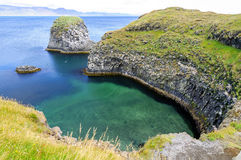 Cliffs and basalt rocks in Arnarstapi, Snaefellsnes peninsula Stock Photos