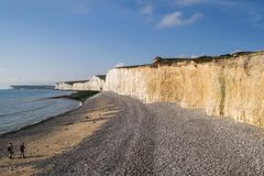 Cliffs and beach at Birling Gap. Chalk cliffs and shingle beach at Birling Gap, England Royalty Free Stock Photo