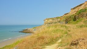 Cliffs and beach of the French Opal north sea coast near Boulogne sur mer. Nord Pas De Calais, France on a sunny day with blue sky stock photography