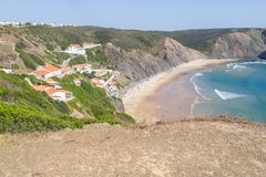 Cliffs, beach and houses in Arrifana Stock Photography