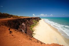 Cliffs and beach at Praia das Minas Stock Photos
