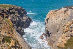Cliffs on the beach,  Vila Nova de Milfontes. Alentejo, Portugal Royalty Free Stock Photography