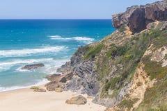 Cliffs on the beach,  Vila Nova de Milfontes. Alentejo, Portugal Royalty Free Stock Photos