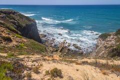 Cliffs on the beach,  Vila Nova de Milfontes. Alentejo, Portugal Stock Photo