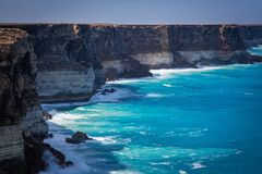 The cliffs of the Bight. Surf smashes up on the cliffs that line Australia`s southern coast Stock Images