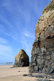 Cliffs and a blue sky. The cliffs and a blue sky at Gwithian sands, Cornwall, UK Stock Images