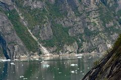Cliffs on both sides of Tracy Arm Fjord Alaska. Cliffs on both sides of Tracy arm Fjords with small icebergs floating in the water royalty free stock photography