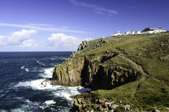 Cliffs and breaking waves at Lands End in Cornwall Royalty Free Stock Photography