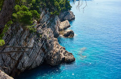 Cliffs. Breaks in the sea near Petrovac town, Montenegro Royalty Free Stock Photos