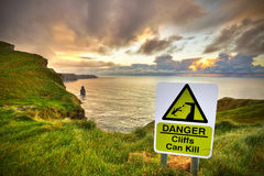 Cliffs can kill sign. On Cliffs of Moher, Co. Clare, Ireland Stock Photo