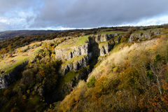 Cliffs of Cheddar Gorge from high viewpoint. High limestone cliffs in canyon in Mendip Hills in Somerset, England, UK Royalty Free Stock Photography