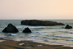 Cliffs on the coast of the Pacific Ocean during sunset in summer royalty free stock photos