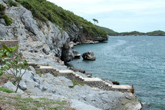 Cliffs coast rock sichang. Seaside cliffs island Ko Sichang in Thailand stock photos