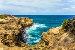 The cliffs are composed of sandstone. The Great Ocean Road of Australia. Picturesque ocean bay with clear green water. The coastal cliffs are composed of royalty free stock images