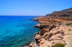 Cliffs of the Cyprus east coast and blue waters of the mediterranean sea Royalty Free Stock Images