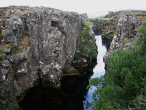 Cliffs and deep fissure in Thingvellir National Park. Southern Iceland Royalty Free Stock Image