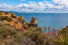Cliffs at the Dona Ana beach, Algarve coast in Portugal Royalty Free Stock Photography