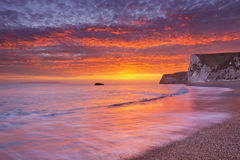 Cliffs at Durdle Door beach in Southern England at sunset Royalty Free Stock Photo