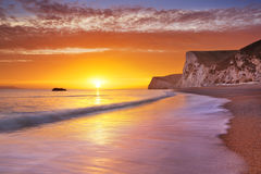 Cliffs at Durdle Door beach in Southern England at sunset Stock Image