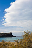 Cliffs at the end of sandy beach in San Pietro island, Sardinia Stock Photography
