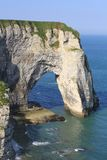 Cliffs at Etretat. The famous cliffs at Etretat from the rocky beach Stock Photos