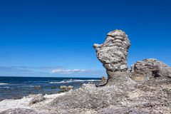 Cliffs on Fårö island in Sweden. Raukar, limestone cliffs on Fårö island in Gotland, Sweden. Baltic Sea coastline Stock Photo